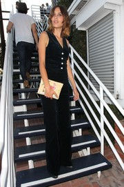 Alexa Chung was '70s-chic in black bell-bottoms and a vest from her collection with AG.