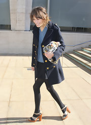 Alexa Chung accessorized her look with platform strappy sandals.