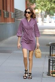 Alexa Chung took a stroll in New York City looking stylish in a striped purple shirtdress.