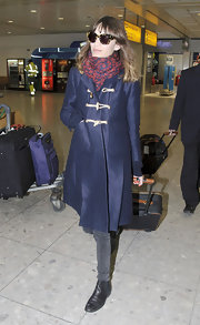 Alexa Chung bundled up at Heathrow in this print scarf and toggle coat.