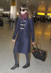 Alexa Chung flew into London wearing a classic pair of black leather ankle boots.
