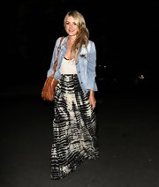 Ali paired a denim jacket over a basic cami over a tie-dye skirt.