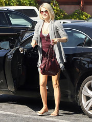 Ali Larter dressed down a sexy burgundy dress with a gray open front cardigan and nude sandals.