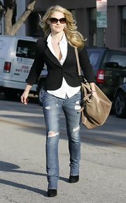 Ali Larter left an LA salon donning a black blazer. ripped jeans and a suede shoulder bag.