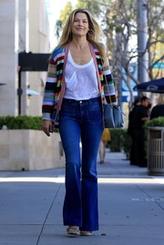 Ali Larter cut a colorful figure on the streets of Beverly Hills in this multi-hued striped cardigan.