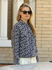 Ali Larter hid her eyes behind a pair of round shades while shopping at Barneys New York.