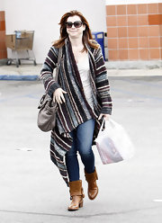Alyson paired her wool sweater and jeans with mid-calf tan boots.