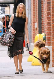 Amanda Seyfried kept comfy in a black tank top while walking her dog in New York.
