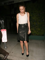 Amber looked edgy in her knee-length black leather skirt while out to dinner.