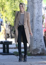 Amber Heard teamed black ankle boots with skinny jeans and a beige coat for a day out in Los Feliz.