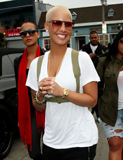 Amber Rose gave her look masculine appeal with a classic gold watch.