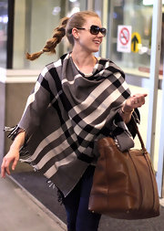 Amy Adams tossed on a plaid shawl for her flight to Vancouver.