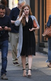 Amy Adams styled her dress with a long gray cardigan.