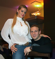Yulia Voronin went for a demure look with a long-sleeve white ruffle blouse.
