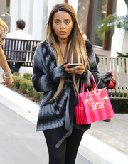 Angela Simmons cozied up to an ombre wrap cardigan outside Victoria's Secret.