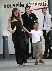 Maddox Jolie-Pitt looked oh-so-relaxed in his plain white tee and beige cargo shorts while shopping with mom Angelina.