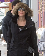 Angelina Jolie kept a low profile with a pair of mirrored aviators and a hooded jacket while out and about in Colorado.
