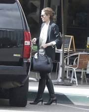 Angelina Jolie kept her classic street style polished with a structured black leather tote.