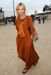 Anja Rubik attended the Chloe fashion show carrying a beige leopard-print shoulder bag.