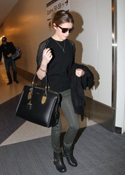 Anna Kendrick was edgy-cool in a black crewneck sweater with perforated detailing during a flight out of LAX.
