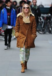 AnnaSophia Robb chose a pair of floral print pants for her bright and cheerful look while out in NYC.