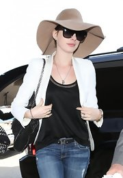 Anne Hathaway chose over-sized shades to hide her famous face while traveling.