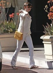 Anne Hathaway kept her look light and bright with white jeans paired with a white blouse.