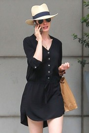 Anne Hathaway kept the rays out with a banded straw hat while strolling in New York City.