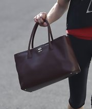 Ashley Greene sported a brown leather tote bag while hitting the gym in LA.