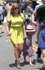 Ariel Winter chose a highlighter yellow dress for her look while hanging out with her sister in California.