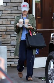 "Ashlley showed off her ""Birkin"" bag while grabbing tons of coffee in her very casual ensemble."