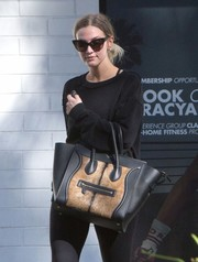 Ashlee Simpson showed off a goat fur-accented Celine Luggage tote as she left yoga class.
