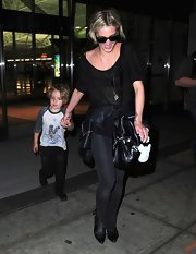 Ashlee Simpson rocker her punk girl look with this sheer black tee paired with a pair of skinny black jeans.