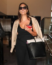 Ashley Graham caught a flight out of LAX carrying a simple black leather tote.
