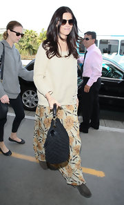 Ashley Greene smartly took the cozy route at the airport wearing this plush ecru sweater.
