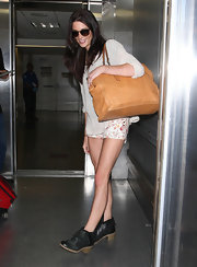 Ashley Greene arrived at LAX looking comfy wearing a pair of black rubber-soled ankle boots.