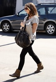 "Ashley Greene showed off her casual side while hitting the LA streets. She flaunted her ""Howard Street"" satchel while making a Starbucks run."
