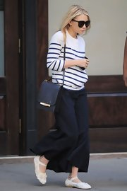 Ashley Olsen wore girlish white rosette- textured Mary Jane flats.