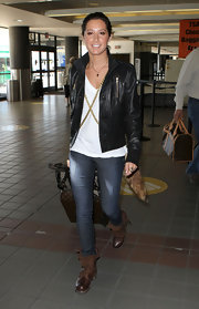 Ashley rolls out of the airport in a leather button-up jacket.