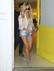 Ashley Tisdale balanced her skin-baring short shorts with a loose tank and cropped moto jacket.