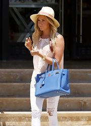 Ashley topped off her sweet day style with this cream hat while out shopping in Beverly Hills.