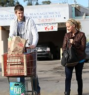 """High School Musical Star"" Ashley Tisdale is seen here with boyfriend Scott Speer toting the ever so popular ""Studded Coco Duffle Bag"". Not only because it's also been sighted on the arms of one of the Olsen twins and Kristen Cavallari, but also because it's not too crazy at $850 and it definitely is unique."