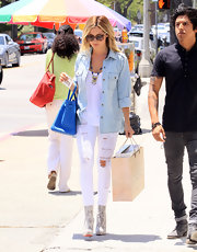 Only Ashley Tisdale could pull off snakeskin ankle-boots in the middle of the day.