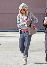 Ashley Tisdale worked on her fitness in a pair of charcoal sweats with a white graphic print.