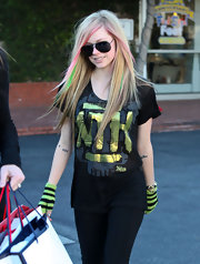 Avril Lavigne added a classic twist to her punk rock look with timeless aviator sunglasses.