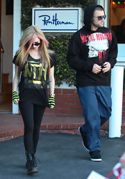 Avril Lavigne added edge to a pair of leggings with 90's favorites, Doc Martens.