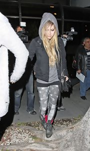 Avril Lavigne stayed true to her signature style with a pair of distressed gray star-print jeans.