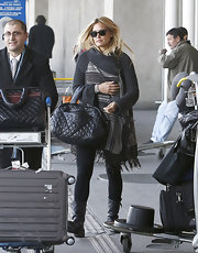 Bar Refaeli kept her travel look luxe with a black quilted leather tote.