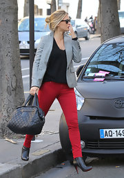 Bar Refaeli toned down her fire engine red pants with a crisp gray blazer.