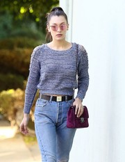 Bella Hadid stepped out for some Christmas shopping rocking a pair of pink aviators.